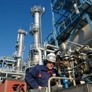 worker in oil refinery, DSP oil and gas and flow measurement, Security Track and Trace